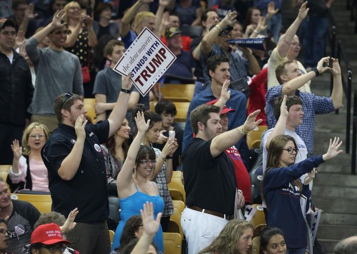 513917024-people-raise-their-arms-as-republican-presidential_1-crop-promo-xlarge2